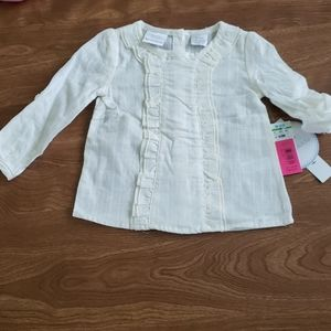 6-9 MONTHS BABY GIRL CREAM COLORED TOP. NWT